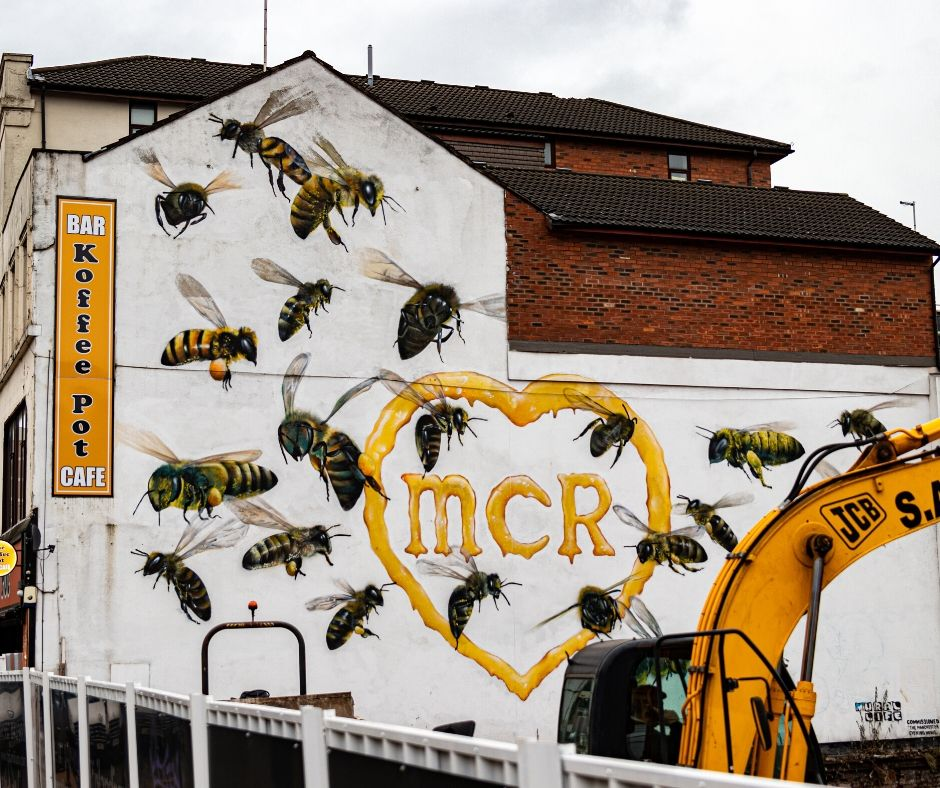 Manchester Bee Artwork on the side of Koffee Pot