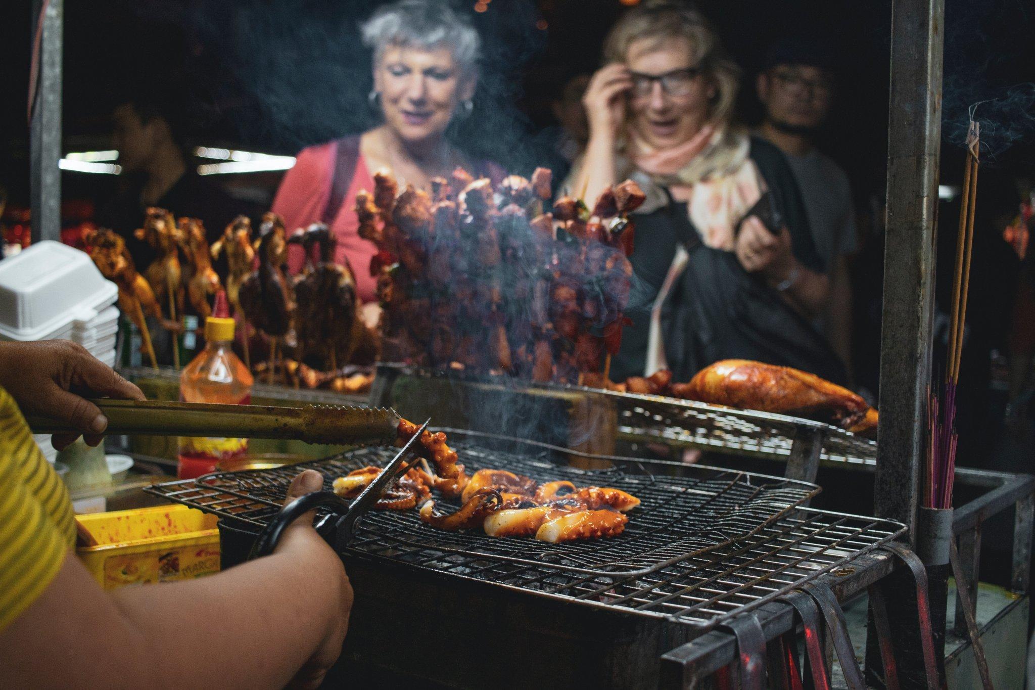 Women staring at food being made